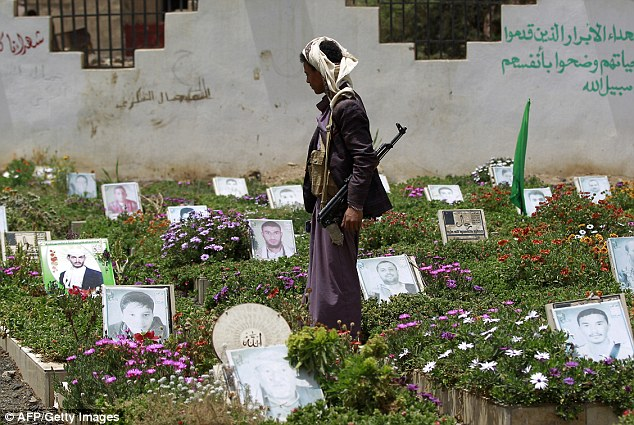 The civil war in Yemen has killed more than 10,000 people - nearly 4,000 of whom are civilians. Another 3 million have been displaced. Pictured, a Houthi supporter visiting a cemetary in Sanaa