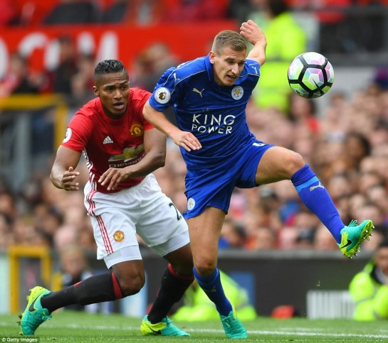 Leicester's Marc Albrighton gets in front of United wing-back Antonio Valencia close to the touchline