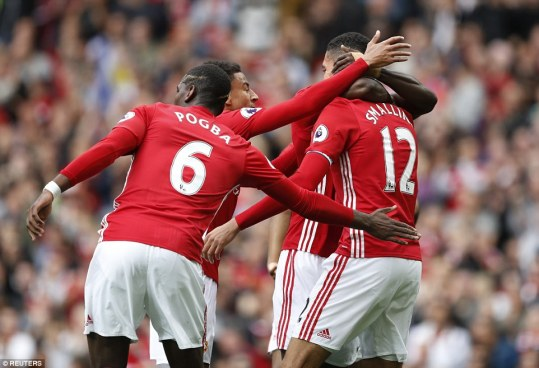 Smalling is congratulated by Paul Pogba, Jesse Lingard and Marcus Rashford as United get in front