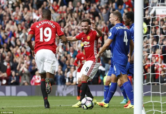 Rashford ran immediately to celebrate with Juan Mata, who played the ball across to him following Blind's corner