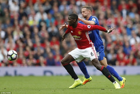 Pogba chases after the ball pursued by Danny Drinkwater during the second-half at Old Trafford