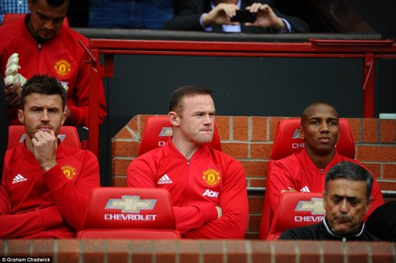 Wayne Rooney watches the early exchanges unfold from his position on the Manchester United subs' bench