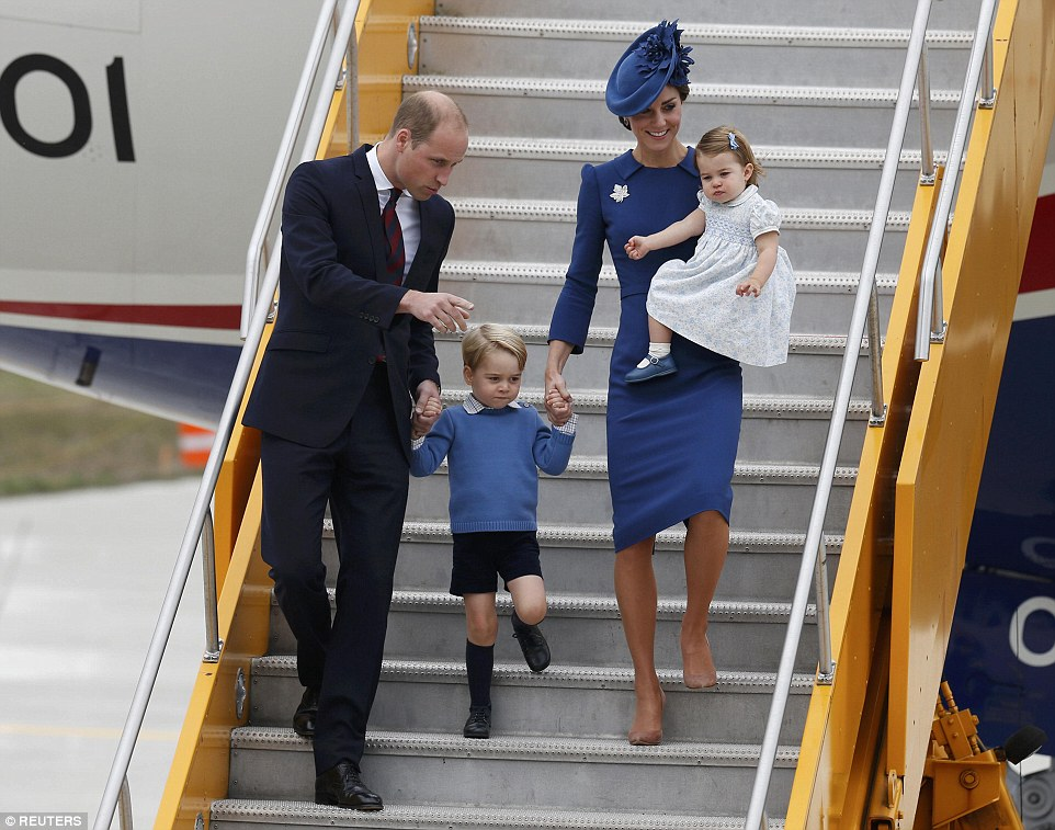 Prince William pointed as he talked to his son - who was wearing a checkered shirt and blue jumper - when the family arrive