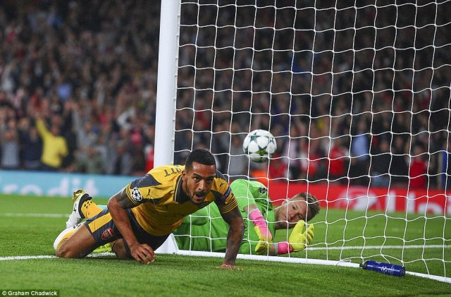 Basle goalkeeperTomas Vaclík is left rooted to the ground as Walcott's early goal puts Arsenal in the driving seat