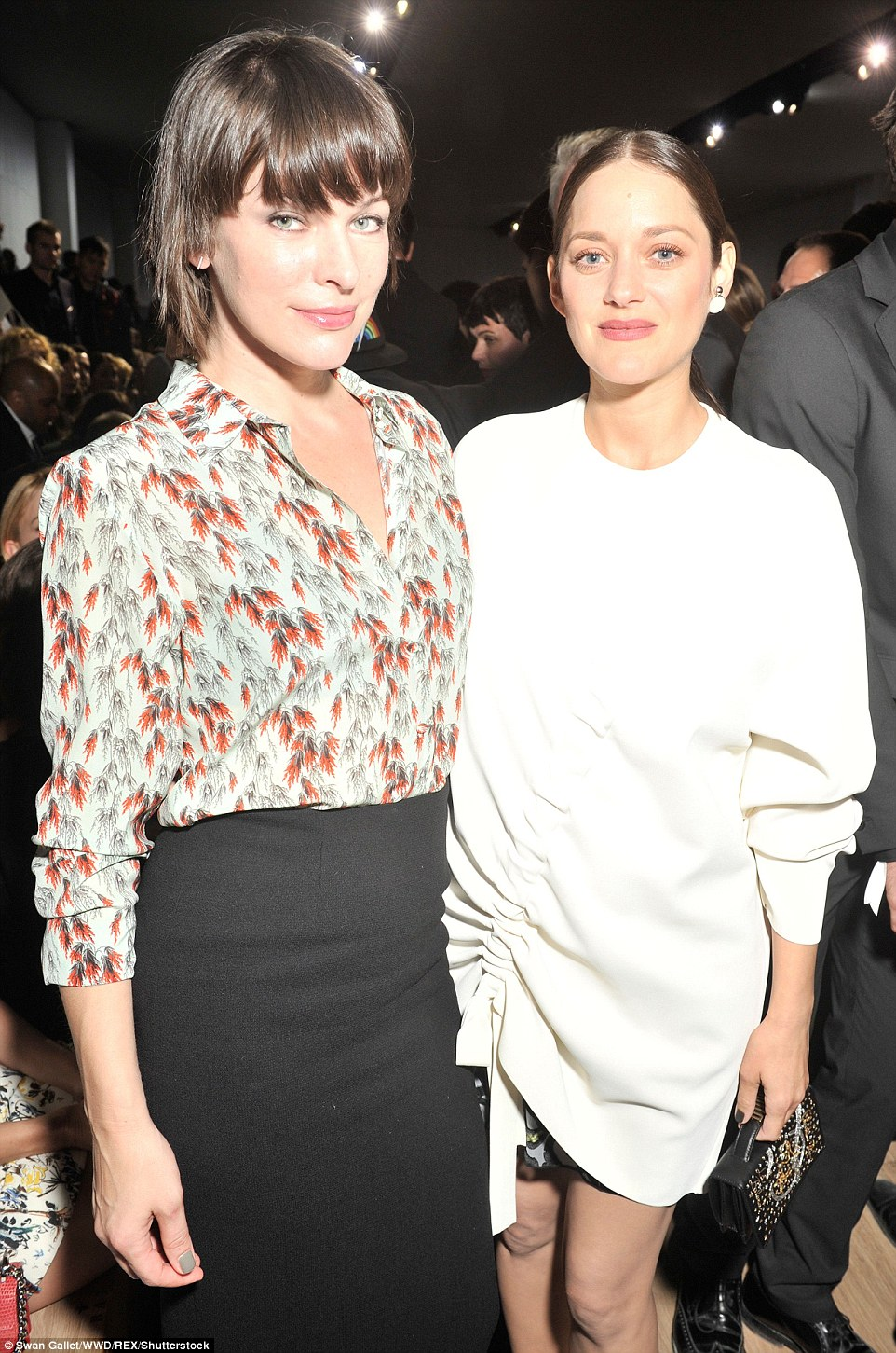 Stars united: She posed for a shot with fellow actressMilla Jovovich at the hot ticket event
