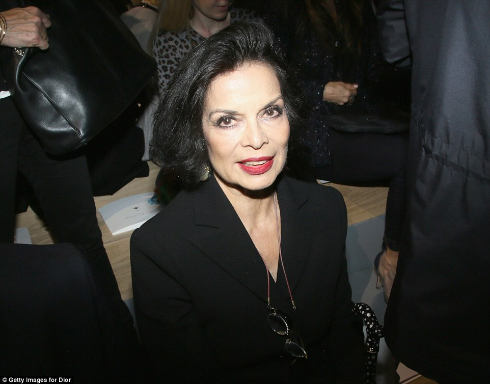 Still got it: Bianca Jagger, 71, was elegant in a black blazer as she took her seat on the front row