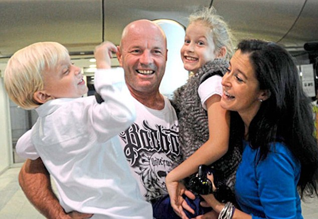 Family: A joyous reunion with his wife Anita and two children Jamie and Zara