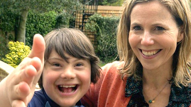 Actress Sally Phillips (right) was accused yesterday of using her DownΏs syndrome son Olly (left) to make expectant mothers feel guilty about abortion