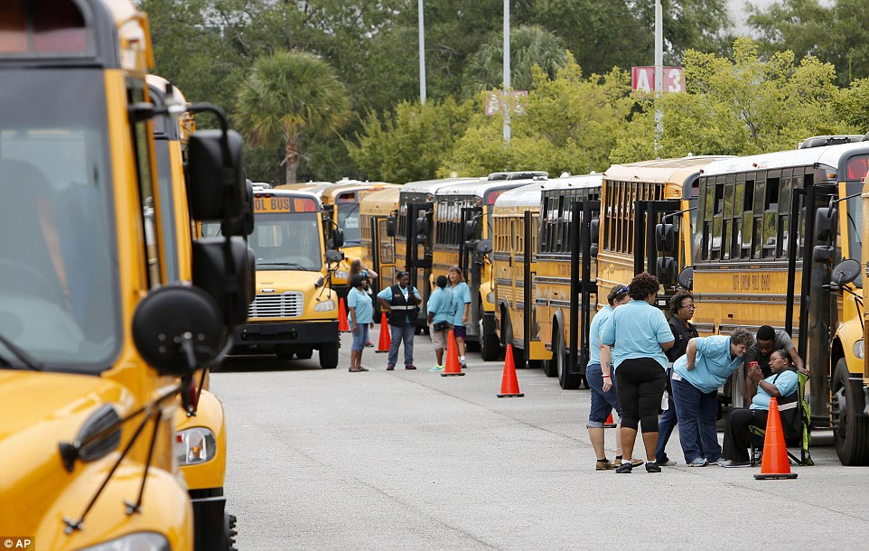 Evacuations have begun across the states as the deadly, storm will hit the East Coast (pictured, bus drivers with the Greenville, South Carolina school district wait for word when to start evacuating people to Greenville from North Charleston)