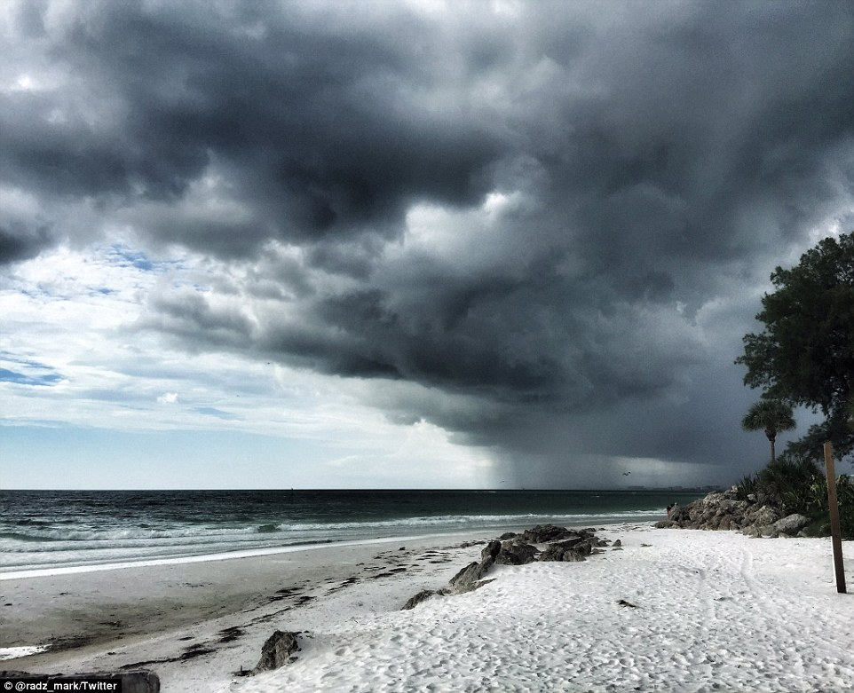 Ominous: Storm clouds rolled in around 4pm on the Siesta Key Beach; Matthew was supposed to touch down on the mainland later this evening or early Friday morning