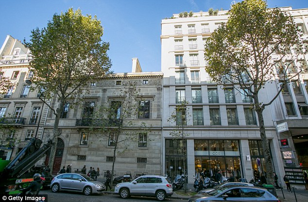 Police are looking at CCTV footage from the area around Kim Kardashian's luxury apartment in Paris (pictured, on the left)