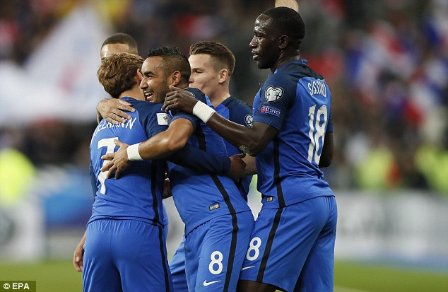 West Ham star Dimitri Payet (centre) is embraced by team-mates after putting France 2-1 up