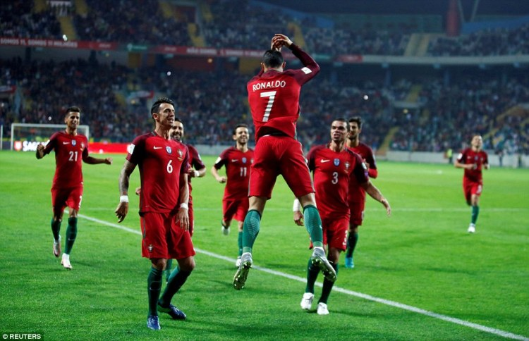 The Portugal talisman with his trademark celebration after scoring against Andorra in Aveiro