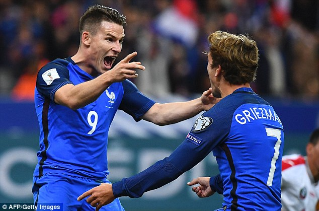 Kevin Gameiro (left) celebrates his second goal after being set up by Atletico team-mate Antoine Griezmann in the 4-1 victory over Bulgaria