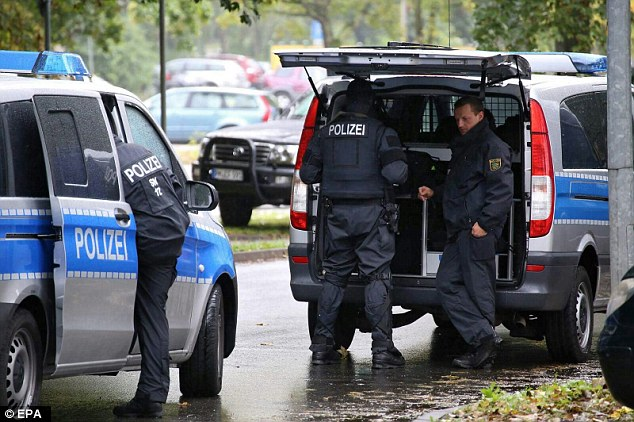 Police officers in Chemnitz, Germany, 8 October 2016. A large-scale police operation is underway in response to a possible bomb attack in an area of Chemnitz