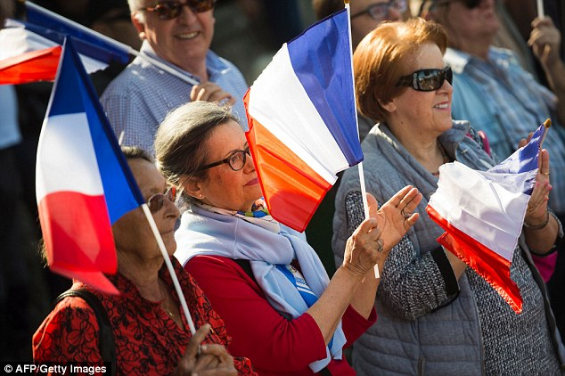 French far-right Front National (FN)'s supporters wave the French flag in the Pierrefeu-du-Var protest