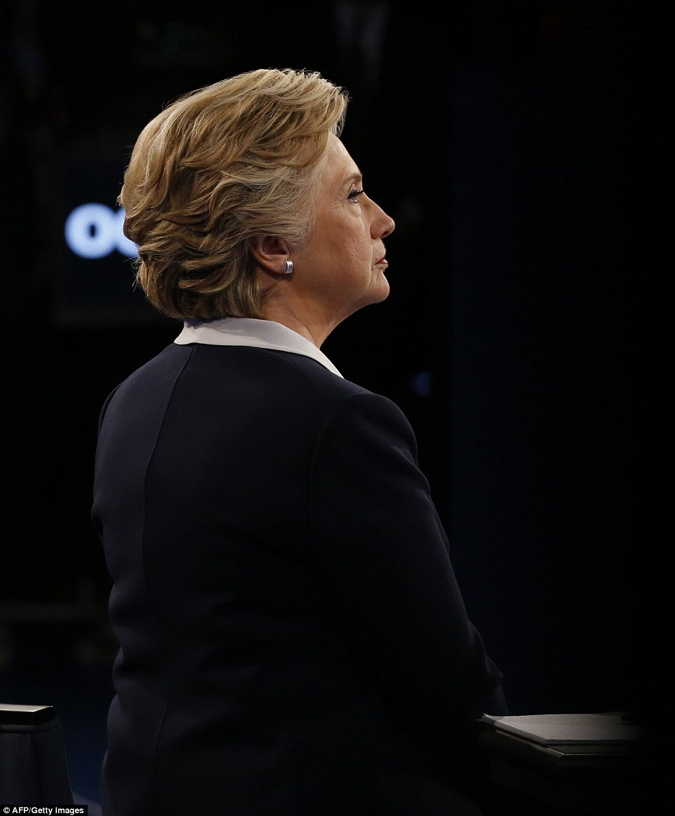 Democratic presidential nominee Hillary Clinton looks on during the second presidential debate at Washington University
