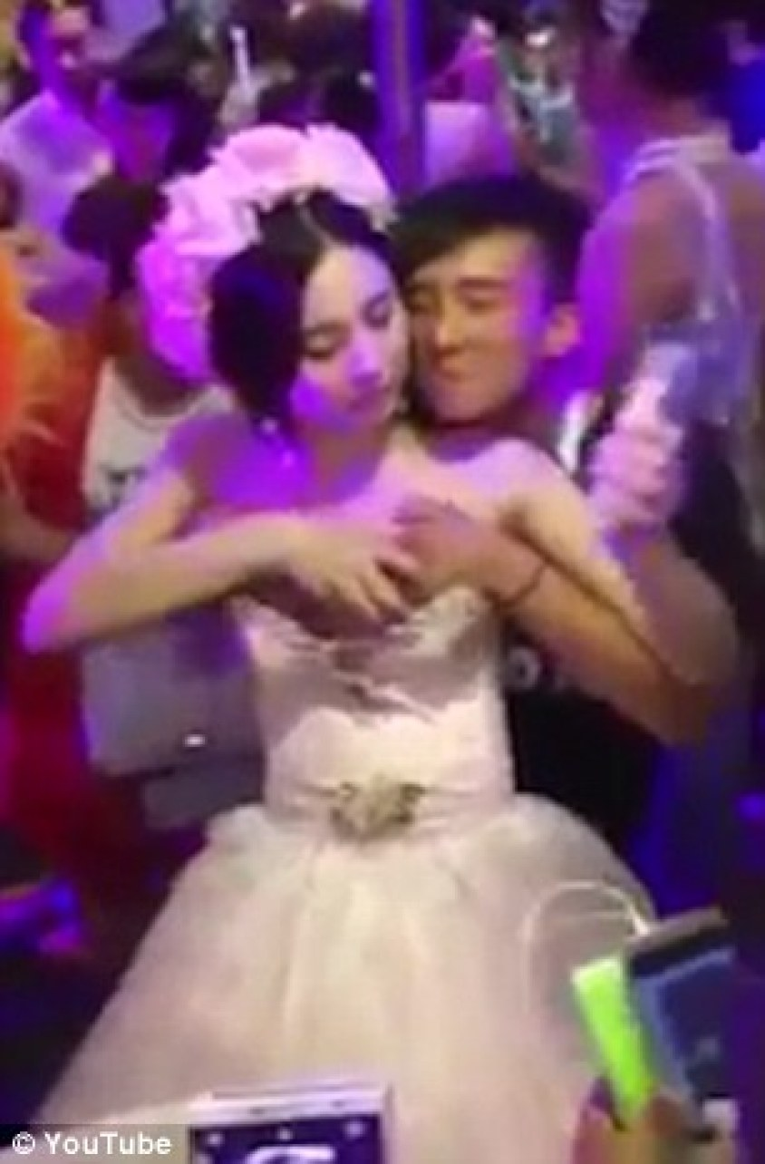 Bizarre footage has emerged of a Chinese newlywed allowing guests to molest her during the ceremony - apparently to raise money for her honeymoon