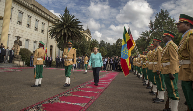 German Chancellor Angela Merkel, center, inspects the honor guard as she arrives at the national palace in Addis Ababa, Ethiopia Tuesday, Oct. 11, 2016. Merk...