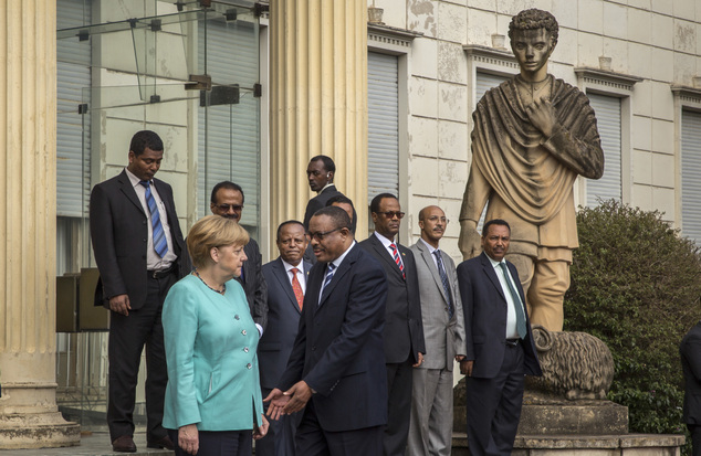 German Chancellor Angela Merkel, left, is welcomed by Ethiopia's Prime Minister Hailemariam Desalegn, center-left, as she arrives at the national palace in A...