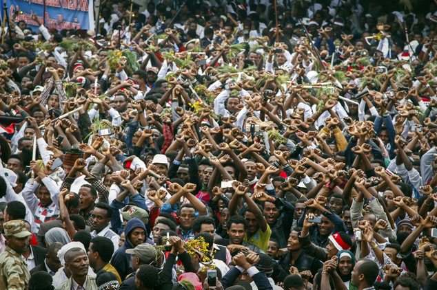FILE - In this Sunday, Oct. 2, 2016 file photo, protesters chant slogans against the government during a march in Bishoftu, in the Oromia region of Ethiopia....