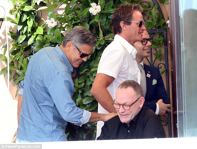 Left-wing 'goliath' of global litigation, Benedict Emmerson QC, being patted on the shoulder by George Clooney
