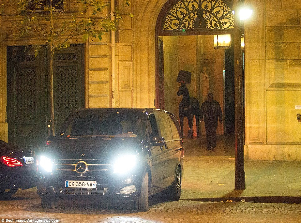 In the interview with the MailOnline Abdulrahman was visibly anxious as he recounted how the gangsters conned their way in. Pictured: Kim is driven away from the crime scene in a black Mercedes people carrier in the early hours of October 3