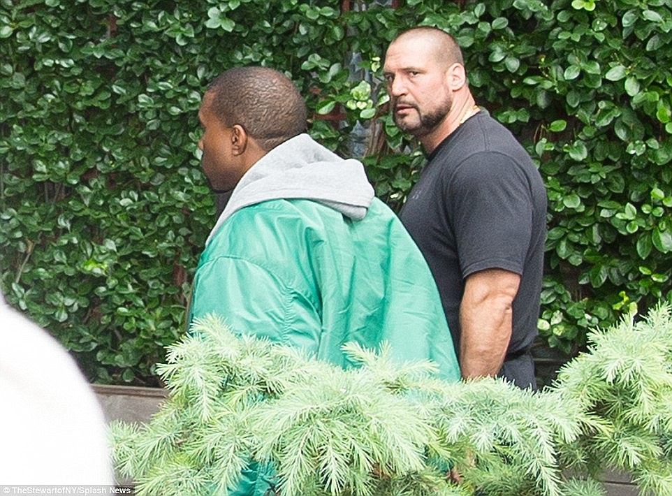 Security shock: The apartment block is arguably the most prestigious in Paris, and is branded 'No Address' because the celebrities who stay there expect utmost discretion. But Abdulrahman said: 'It was No Address, no security'. Pictured: Kanye with Kim's German-born bodyguard Pascal in New York after the robbery