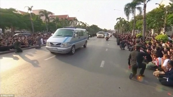 The hundreds of citizens and officials in the crowds knelt down as the royal convoy passed through Bangkok