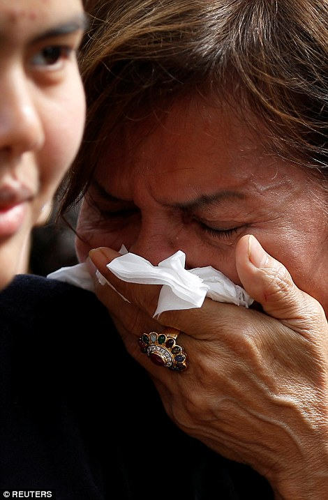 Many Thai woman have been seen crying, some uncontrollably, as the country goes into a year's morning with many activities closed for the next month