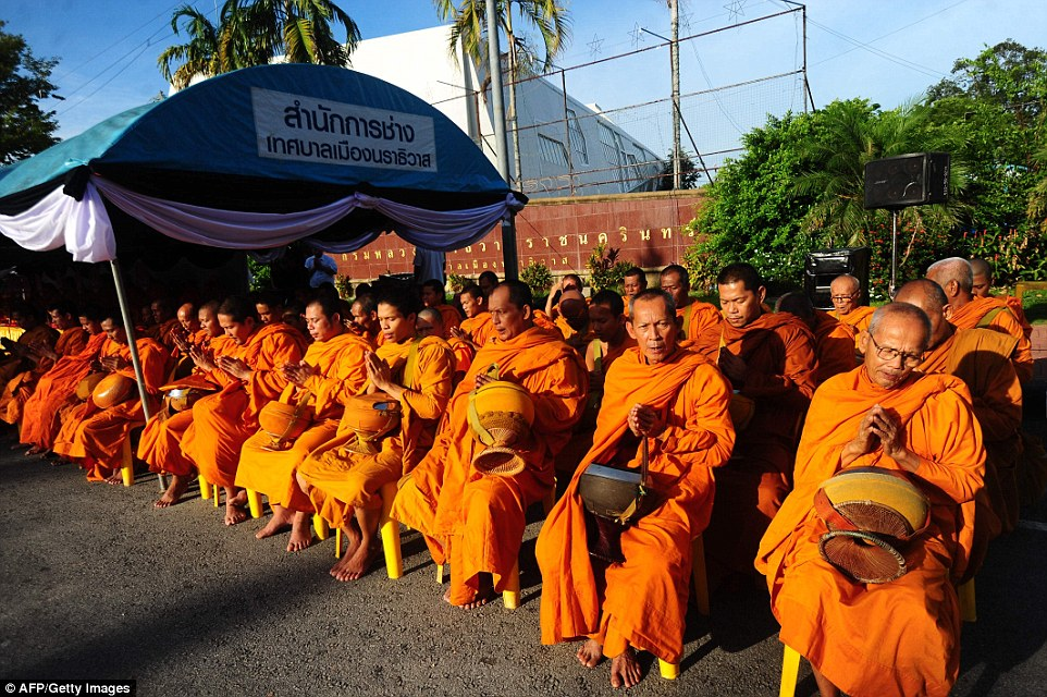 Buddhist monks pray for the late Thai King Bhumibol Adulyadej in Thailand's southern province of Narathiwat on Saturday