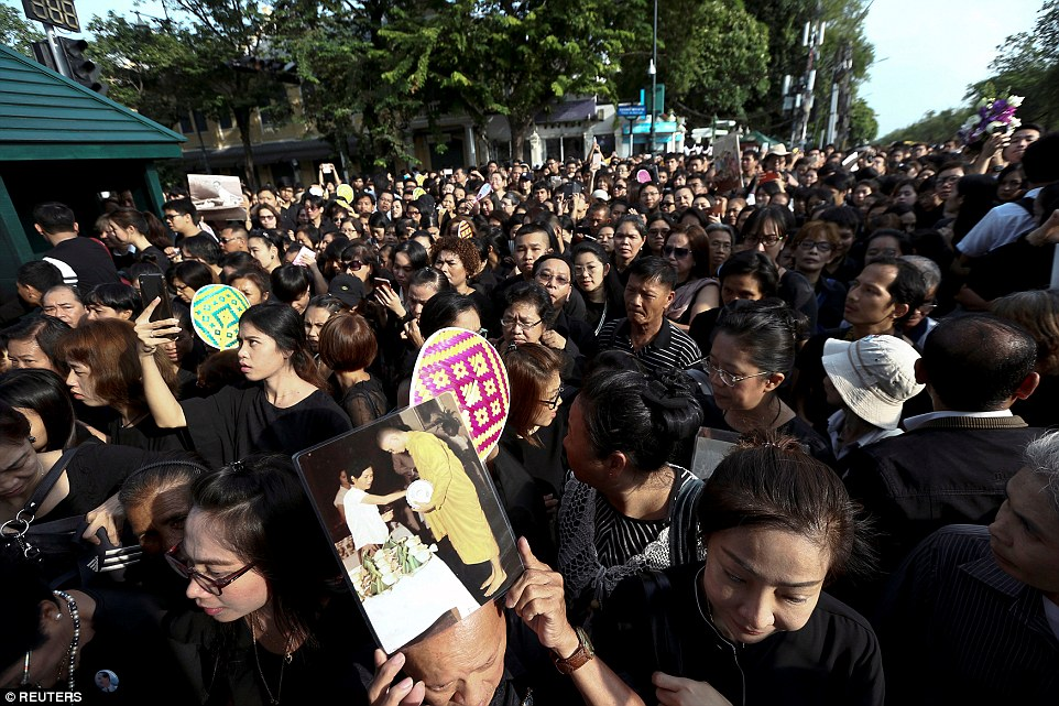 Mourners gather outside of the Grand Palace, some from very early this morning, to pay respects despite announcements that it is closed