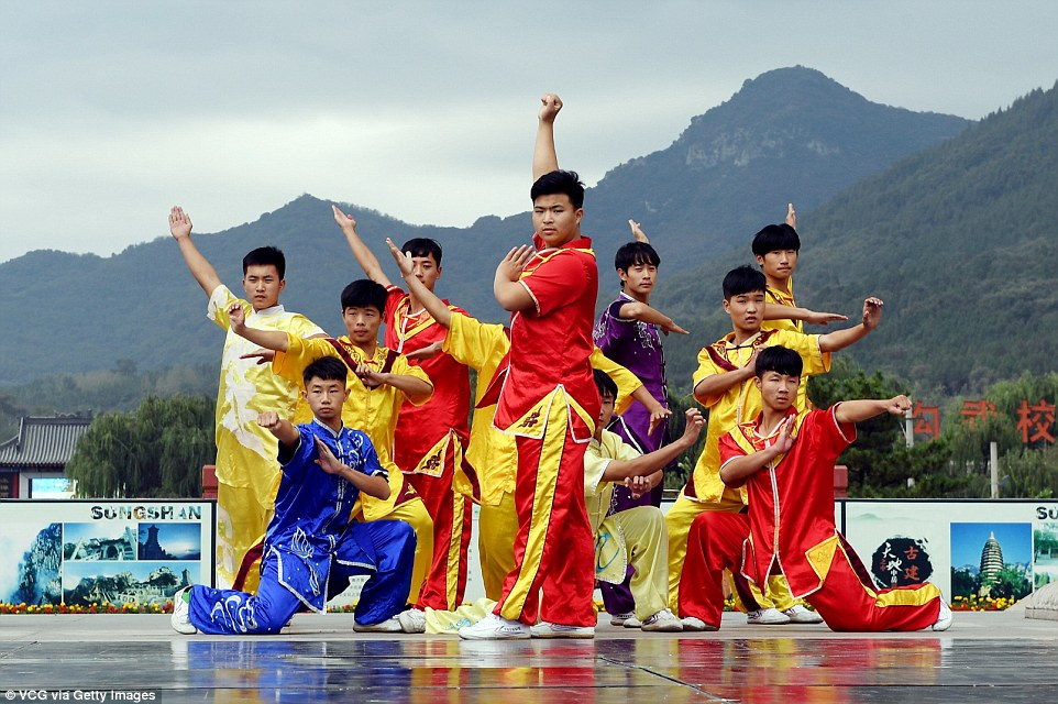 The hundreds of competitors don brightly coloured uniform for their international festival, in gold, red and blue