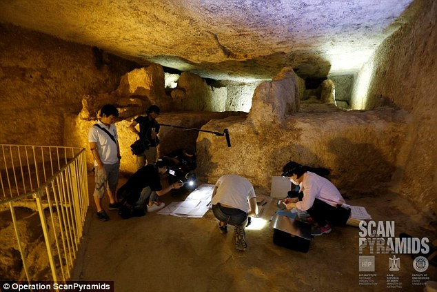 Researchers work on muons emulsion plate setup in the Khufu pyramid's lower chamber