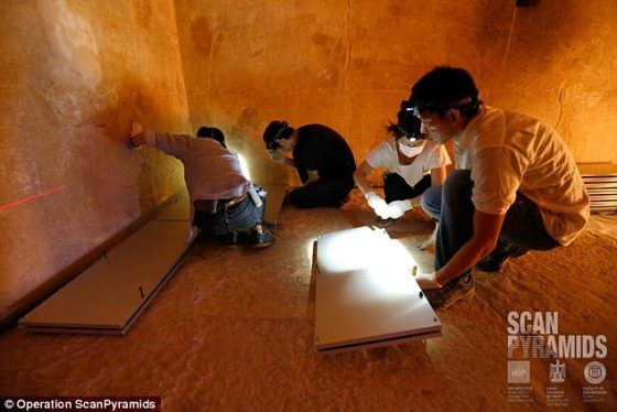 Experts from the Operation ScanPyramids team investigate the inside of the ancient structure