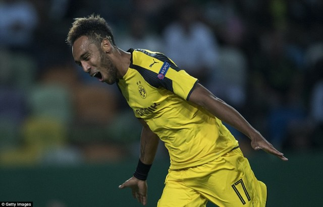 Gabon international forwardAubameyang sprints away to celebrate after giving his side the lead in Portugal