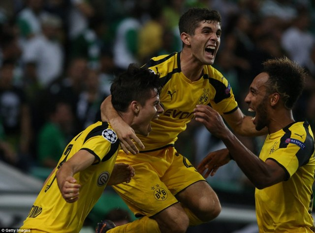 Young midfielderJulian Weigl celebrates with team mates after doubling the advantage with what proved to be the winner