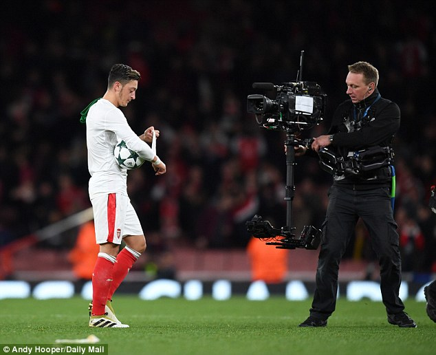 ozil walking home with the matchball