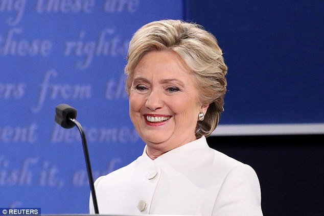 Clinton's happy expression became a talking point at earlier debates. It continued to peak viewers' interests at her final showdown with Trump on Wednesday (above)
