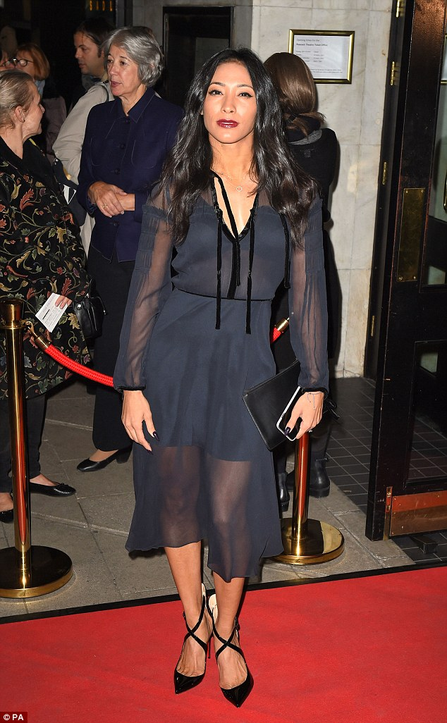 Simply stunning:Karen, 34, chose a chic navy layered dress for the night at the theatre which flashed a glimpse at her long legs