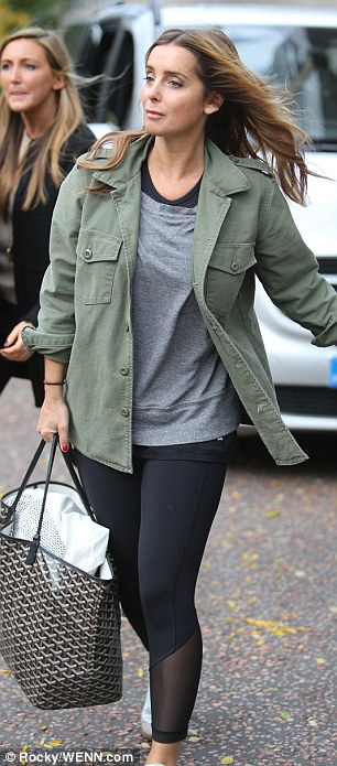 Military chic: Wearing tight leggings and a loose grey sweater, the former Eternal star layered it with a khaki cargo jacket