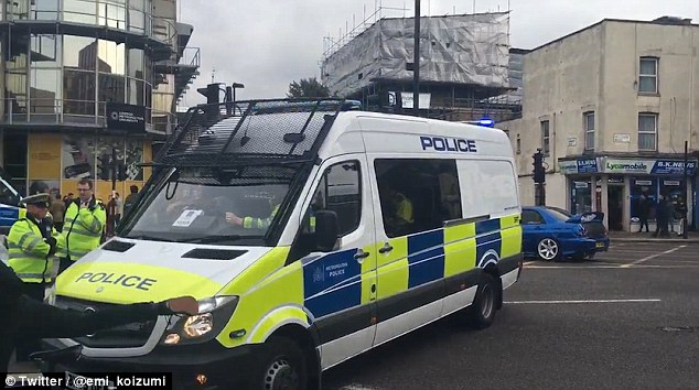 Arrest: The teenager was detained at 12.20pm in Holloway, North London, one day after the item was detonated in a controlled explosion at North Greenwich station