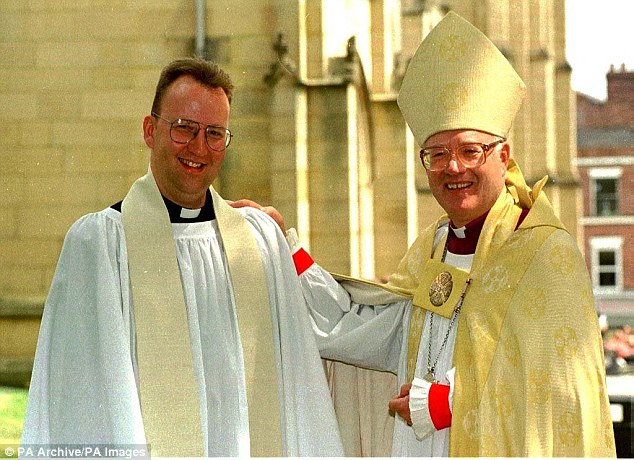 Mark Carey (left) with his father, who was The Archbishop of Canterbury, at Wakefield Cathedral after ordained as a priest in the Church of England in 1995