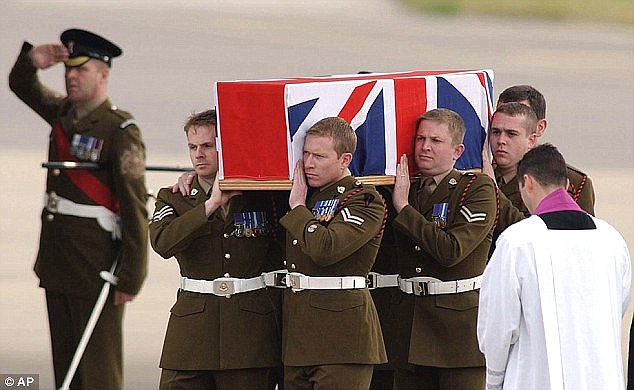 One of the ambushed men is brought home with military honours after being killed in Iraq
