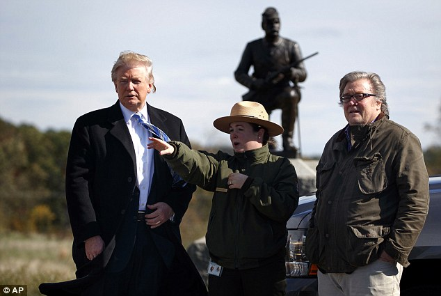 Trump stopped at the Gettysburg National Military Park after his speech, speaking with Park ranger Caitlin Kostic (center) and campaign CEO Steve Bannon (right) near 'Cemetery Ridge' where Confederate general Robert E. Lee ordered the attack known as Pickett's Charge
