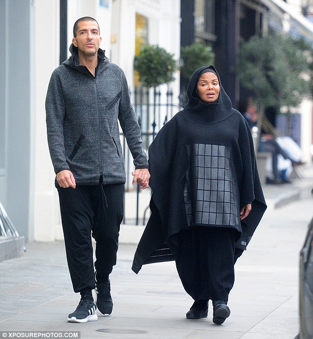 Comfy: The 50-year-old All For You hitmaker covered herself from head-to-toe in a billowing hooded poncho with baggy trousers and comfortable trainers