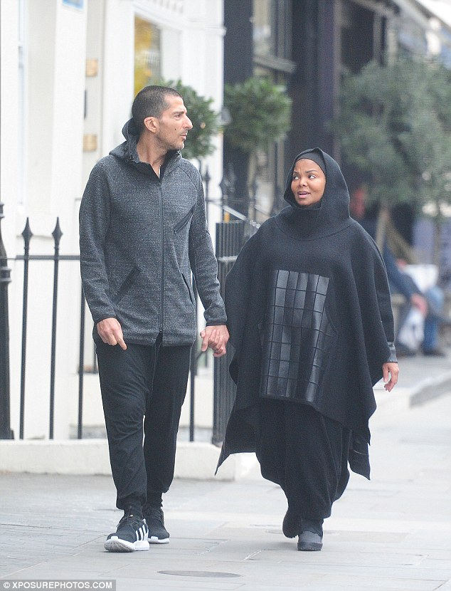 Wrapped up: Janet Jackson took to the streets of London earlier in the week wearing Islamic-style dress while walking hand in hand with her husband Wissam Al Mana