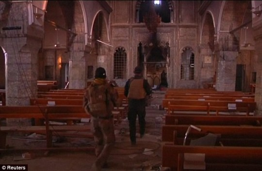 The militants captured Mosul in the summer of 2014, when they swept across much of northern and western Iraq. Pictured are Iraqi troops inside one of the churches in Bartella