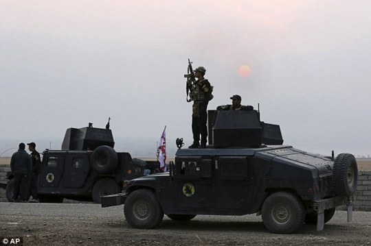 Iraq's elite counter-terrorism forces prepare to attack Islamic State positions as fighting to retake the extremist-held village of Tob Zawa, outside Mosul
