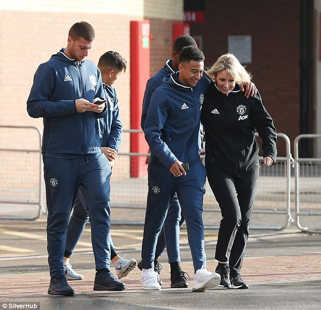Jesse Lingard with Manchester United's first team PA Jackie Kay and Sam Johnstone